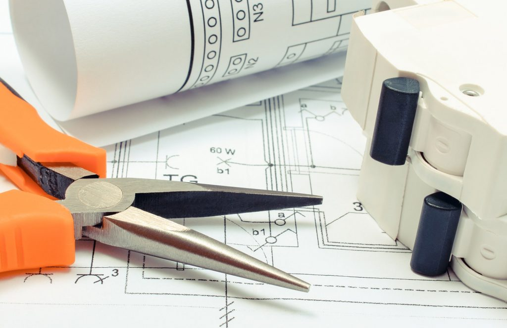 Electrical diagrams, electric fuse and pliers on construction drawing of house